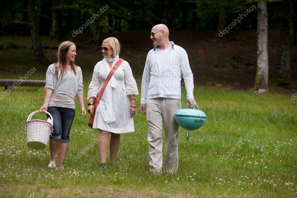 Friends walking in park ready for a BBQ picnic  Stock Photo #11795296