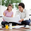 Female Looking At House Plan — Stock Photo