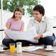Stock Photo: Female Looking At House Plan