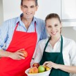 Happy Couple in Kitchen with Fruit — Stock Photo