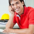 Foto de Stock  : Happy Architect Sitting By Desk