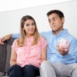 Man Holding Piggybank While Sitting With Woman — Stock Photo