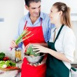 Man and Woman Cooking in Kitchen - Stock Photo