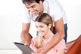 Young Couple Using Digital Tablet — Stock Photo
