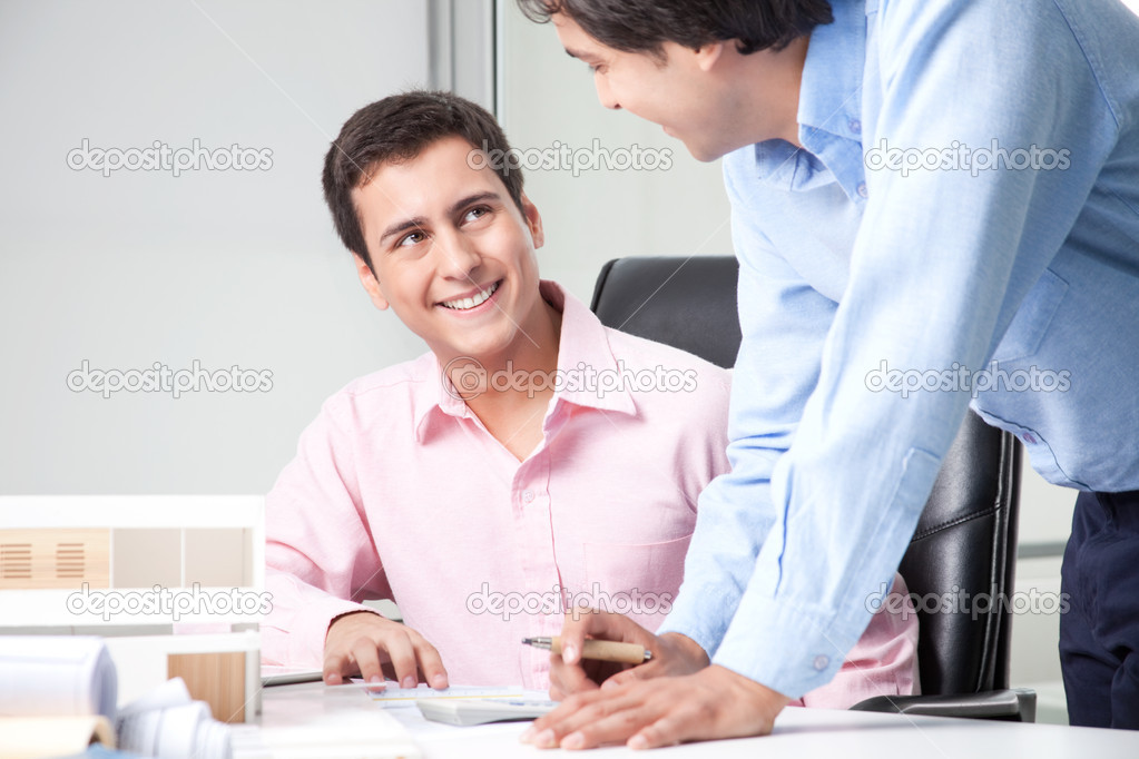 Two male architect at workplace with blueprints. — Stock Photo #12191776