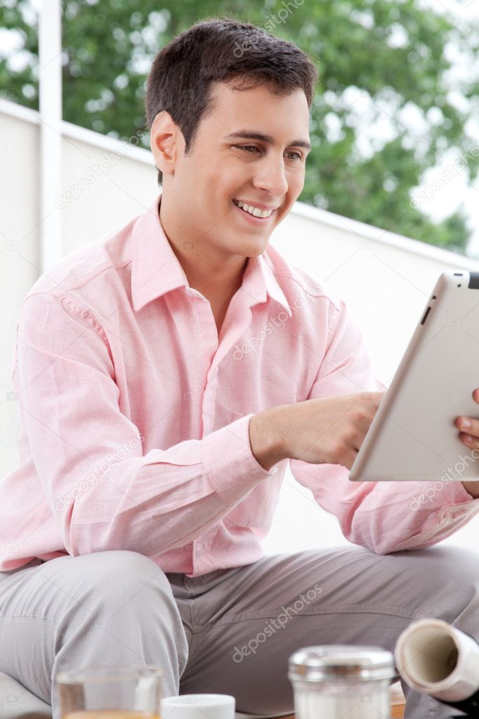 Happy young architect using digital tablet.  Stock Photo #12191880
