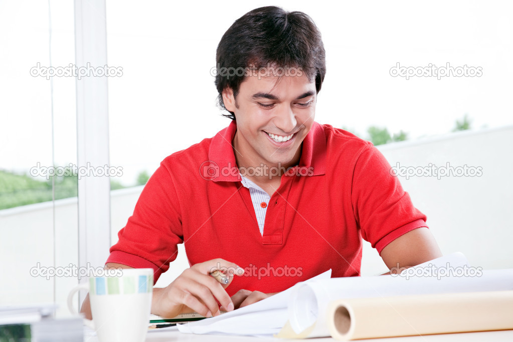 Portrait of professional architect with blueprints. — Stock Photo #12192574