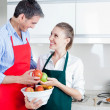 Happy Couple in Kitchen Preparing Food — Stock Photo #12218920