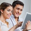 Royalty-Free Stock Photo: Young Couple With Tablet PC