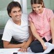 Stock Photo: Couple With House Plans