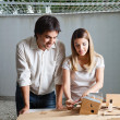 Female Architect Working On Model House — Stock Photo