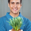 Man Holding Small Plant - Foto de Stock
