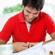 Stock Photo: Male Architect Working On Blueprint