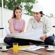 Stock Photo: Architect Team Discussin House Plans