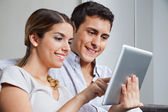 Young Couple With Tablet PC — Stockfoto