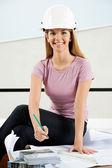 Female Architect Working On Blueprint — Stock Photo