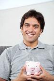 Happy Man Holding Piggybank — Stock Photo