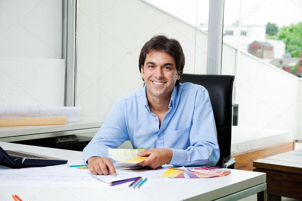 Male interior designer at work stock photo simplefoto for Interior design work