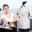 Stock Photo: Female Fashion Designer Taking Measurement