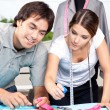 Two Fashion Designer Working Together - Stock Photo