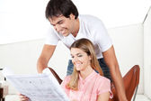 Young Couple Looking at Blueprints — Stock Photo