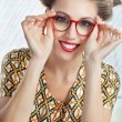 Woman Wearing Red Vintage Eyeglasses - Stock Photo