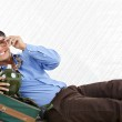 Businessman Lying With Travel Bag — Stock Photo #12329330