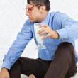 Geek Holding Healthy Drink — Stockfoto