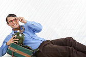 Businessman Lying With Travel Bag — Stock Photo