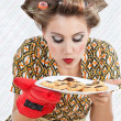 Stock Photo: WomSmelling Plate Of Cookies