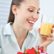 Jovial Businesswoman Holding Orange Juice — Stock Photo #12331077