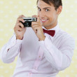 Male Geek Holding Retro Camera - Stockfoto