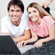 Young Couple Using Laptop — Foto Stock