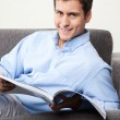 Young Man Holding Magazine — Stock Photo #12335068