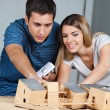 Couple Working On Model House — Foto Stock