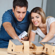 Couple Working On Model House — Stock Photo
