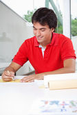 Architect Drafting a Blueprint — Stock Photo