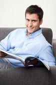 Young Man Holding Magazine — Stock Photo