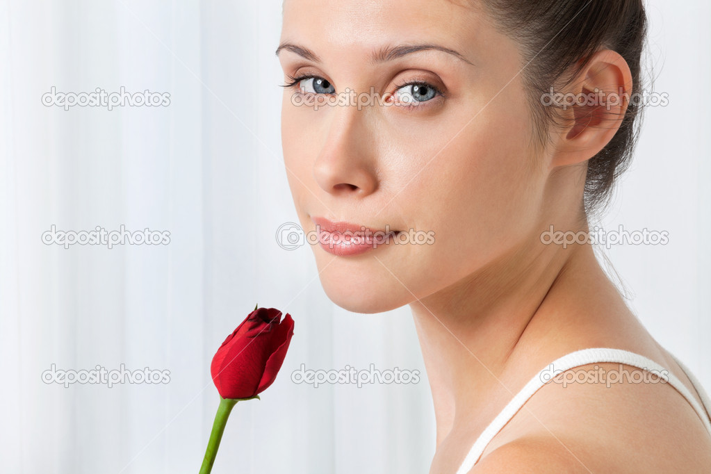 Portrait of pretty young female with red rose over white background — Stock Photo #12330769