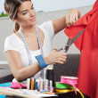 Stock Photo: Designer Cutting Red Fabric