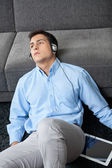 Man Listening Music On Digital Tablet — Stock Photo