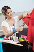 Designer Cutting Red Fabric — Stock Photo
