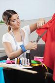 Designer Cutting Red Fabric — Stock Photo