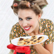 Happy Woman Holding Plate Of Cookies — Stock Photo