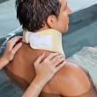 Man Receiving Back Massage - Stock Photo