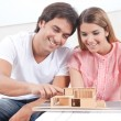 Couple Looking at House Model — Stock Photo