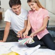 Couple Choosing Color From Swatches — Stock Photo #12382558