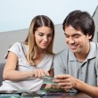 Couple Choosing Glass Tile Swatches — Stock Photo #12395107
