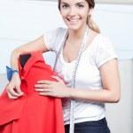 Female Dressmaker Adjusting Clothes — Stock Photo