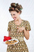Woman Winks As She Holds Plate Of Cookies — Stock Photo